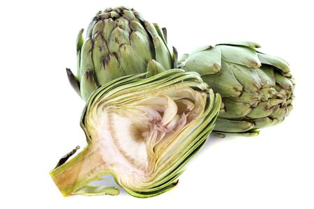 three artichokes in front of white background photo