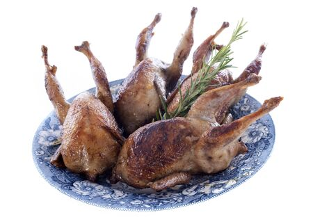 carcass meat: four quails  baked on a white background Stock Photo