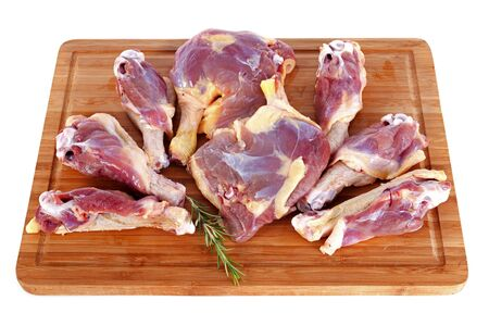 duck meat on a cutting board in front of white background Stock Photo - 17333384