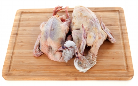 two pigeon meat on a wood cutting board Stock Photo - 17841219