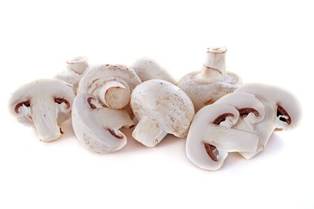 button mushrooms in front of white background