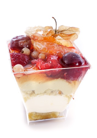 fruit mousse in a verrine in front of white background Stock Photo - 18257744