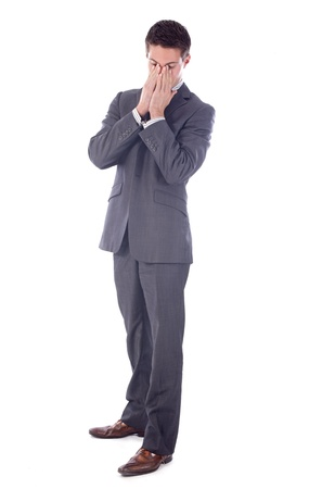 angry businessman: young business man worried  in front of white background Stock Photo