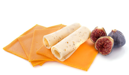 emmental: slices of mimolette and emmental in front of white background