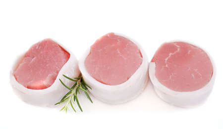 veal tournedos in front of white background Stock Photo - 23580234