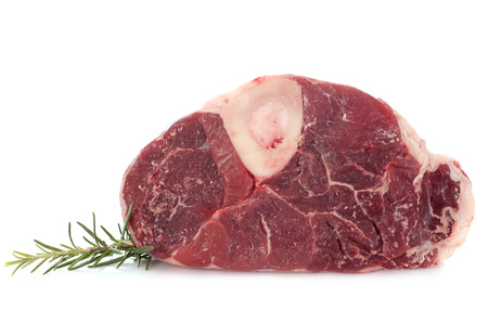 leg of beef in front of white background Stock Photo - 23637283