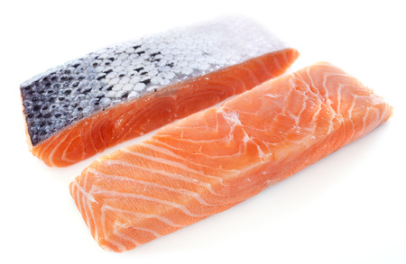 redfish: salmon fillets in front of white background