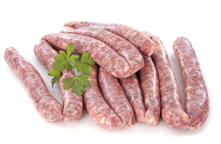varkensvleesworsten voor witte achtergrond Stockfoto