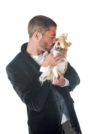 man dog: man and chihuahua in front of white background