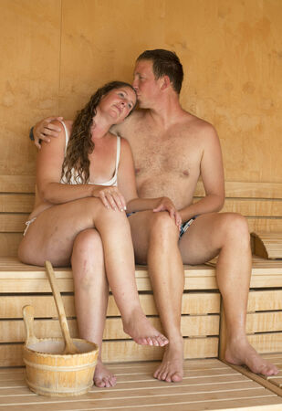finland sauna: Beautiful young woman relaxing at finnish sauna  Stock Photo