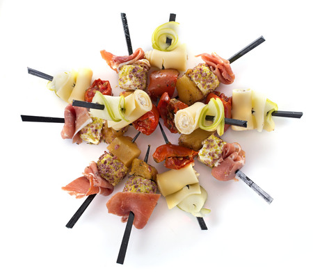aperitive: aperitive brochette in front of white background