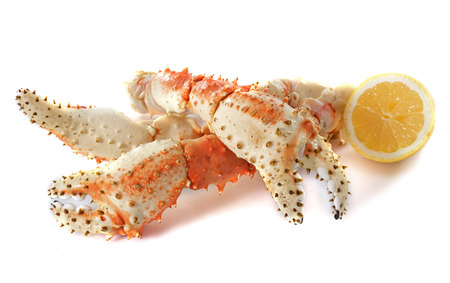 crab legs: Red king crab in front of white background