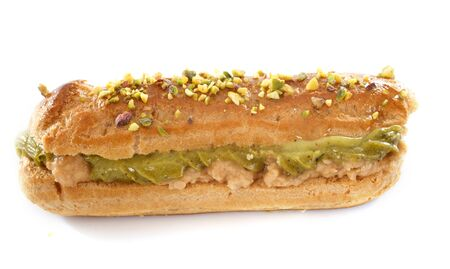 eclair: pistachio eclair in front of white background