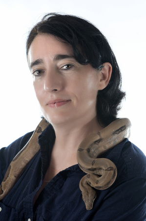 young friends: woman and snake in front of white background