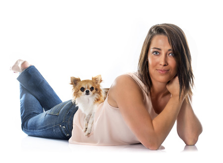 dog isolated: young woman and chihuahua in front of white background Stock Photo