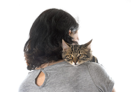 woman and kitten in front of white background