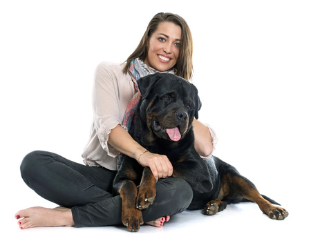 rottweiler: woman and rottweiler in front of white background