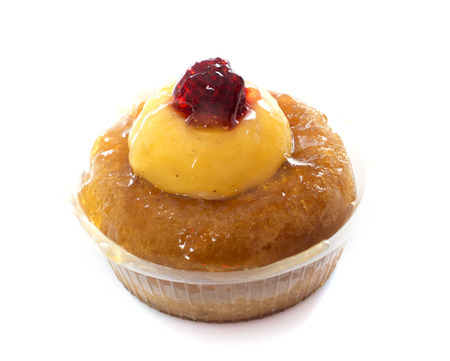 rum baba cake in front of white background