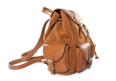 rucksack ': brown leather bag in front of white background Stock Photo