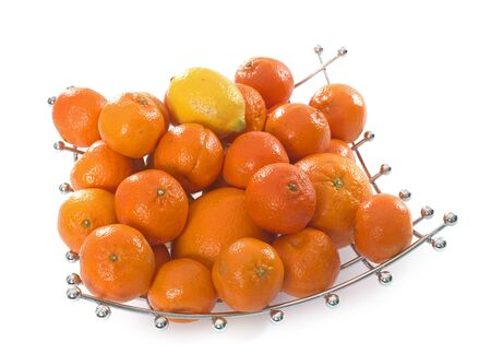 fruit bowl: citrus fruit in fruit bowl in front of white background Stock Photo