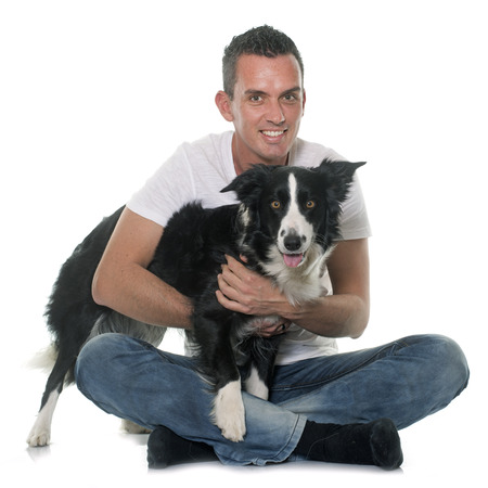 white person: man and border collie in front of white background Stock Photo
