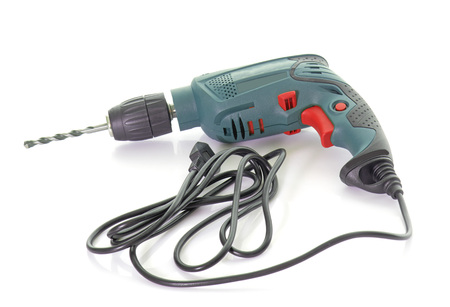 power drill: power drill in front of white background