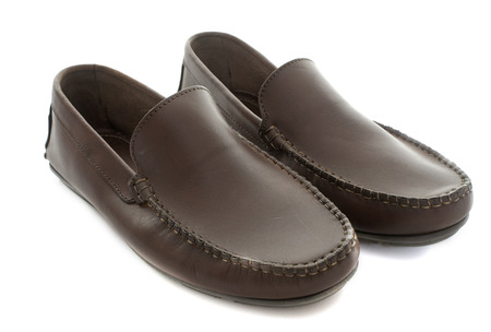 loafer: brown loafer in front of white background