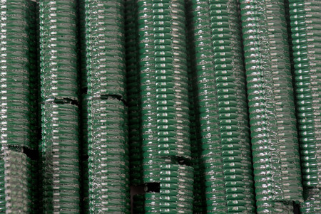 wire fence: staples for wire fence in front of white background