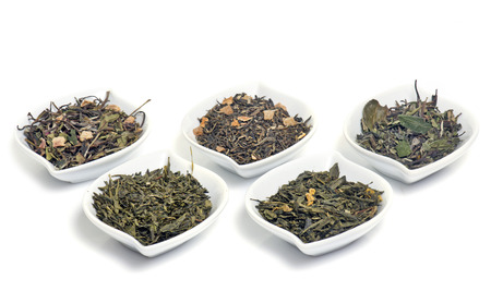 tannin: leaf of tea in front of white background Stock Photo