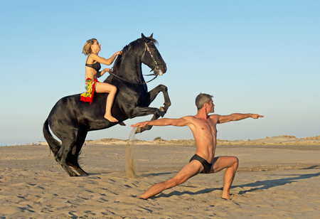 galloping: horse woman and yoga man on the beach