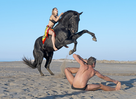 horse andalusian horses: horsewoman and her horse  and yogi on the beach Stock Photo