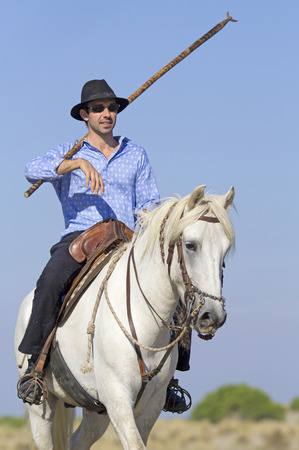 herdsman: herdsman riding on his camargue for selecting the livestocks Stock Photo
