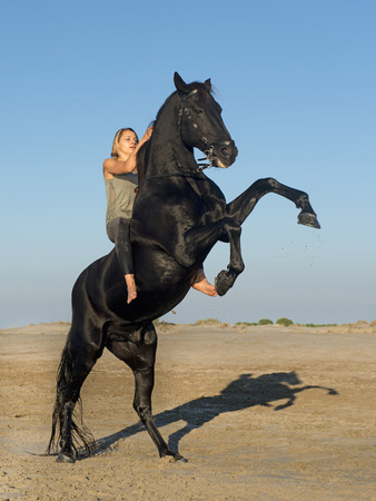 rearing: horse woman and rearing stallion on the beach Stock Photo