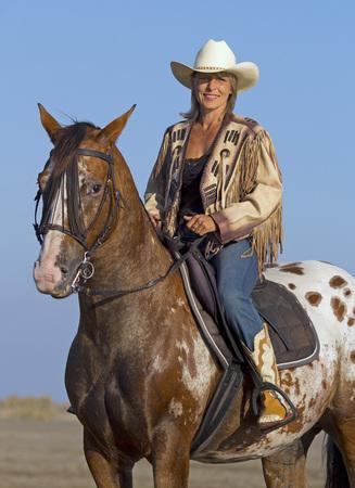 appaloosa: cowgirl on appaloosa horse on the beach