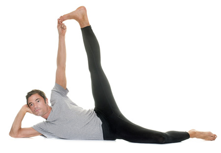 flexion: yoga man in front of white background