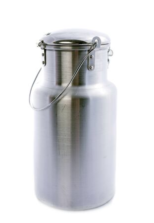 metal milk churn in front of white background