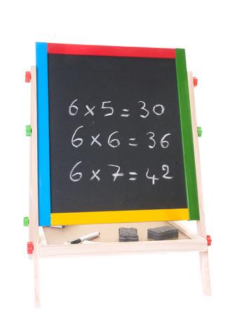 little blackboard in front of white background