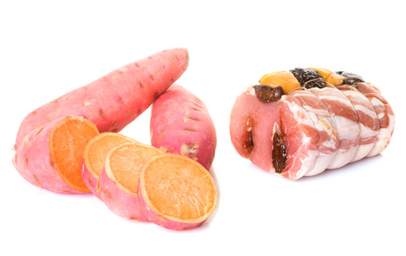 pork joint with fruit in front of white background Stock Photo