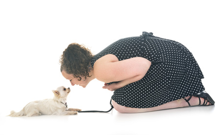 woman and chihuahua in front of white background
