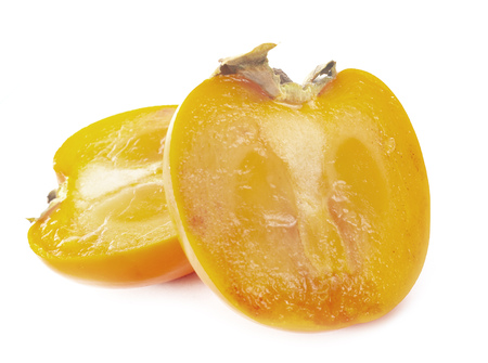 open persimmon in front of white background