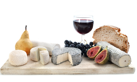 platter of cheeses in front of white background Foto de archivo