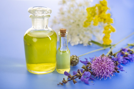 essential oils in front of white background Stock Photo