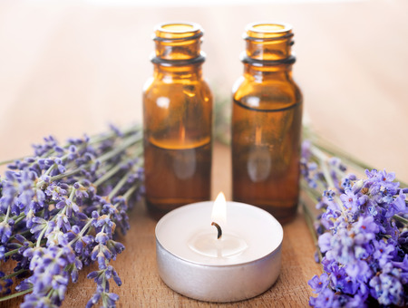 lavender and essential oils in front of white background