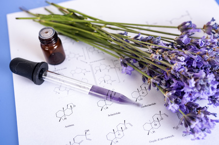 lavender and essential oils on a table Stock fotó