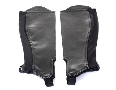 leather chaps in front of white background