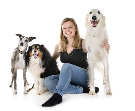 dogs and woman in front of white background