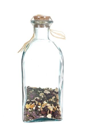 bottle with spices in front of white background