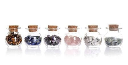 flask with gems in front of white background