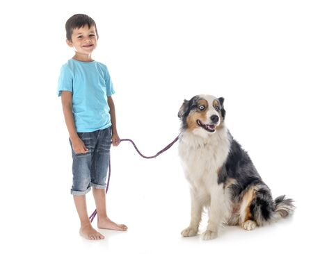child and dog in font of white background 스톡 콘텐츠