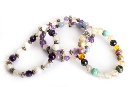 gem bracelets  in front of white background